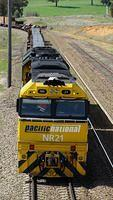 NR21 trundles to a stop to let XPT pass