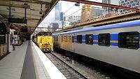 XR551 pulling freight through Flinders Street