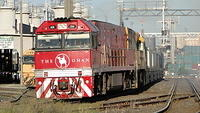 NR74 on freight departing Dynon