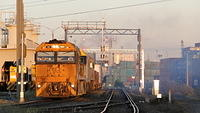 NR68 on freighter departing Dynon