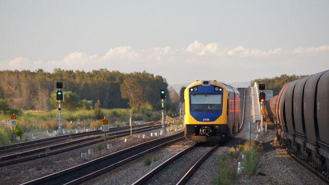Hunter Railcar passing coal at Sandgate