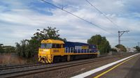 NR48 light engine past Middle Footscray
