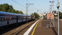 The Overland passes a ComEng at Middle Footscray